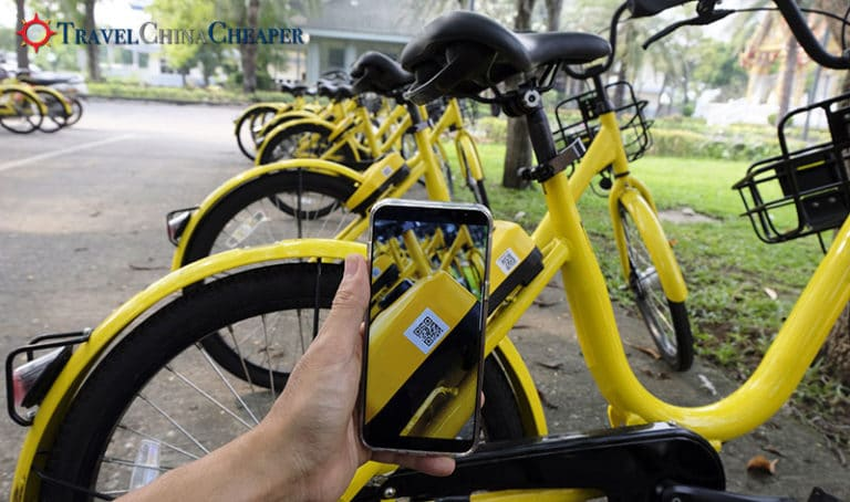 Scan the QR code on a bike share in China bicycle to unlock