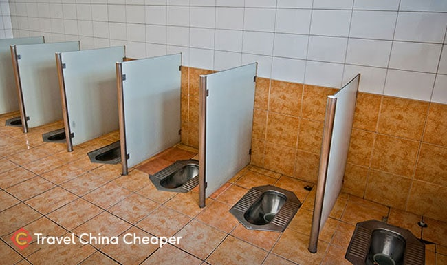"""An example of Chinese squat toilets, or """"squatty potties"""""""