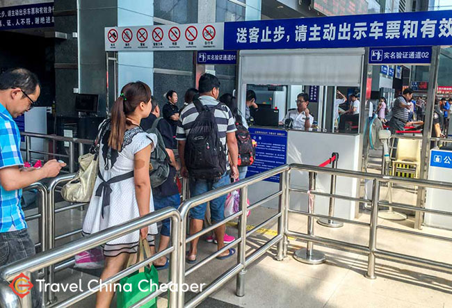 Having your ticket and ID checked at a China train station