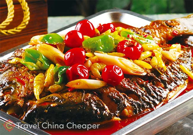 Try Chongqing Fried Fish (重庆烤鱼), a popular Chinese food for tourists