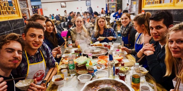 Travelers enjoy food with Chengdu Food Tours in Sichuan
