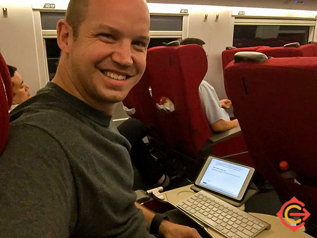 Me writing this guide while on a China train.