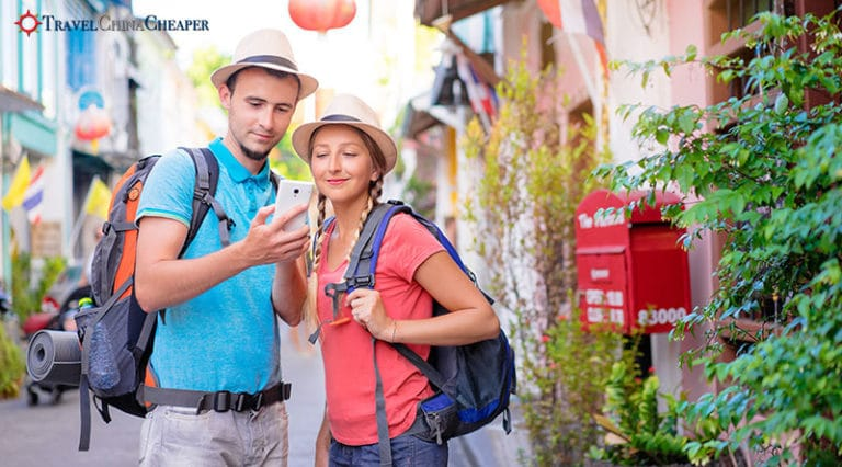 Travelers in China using a mobile phone