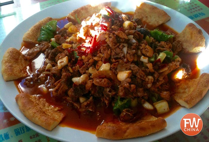 Xinjiang Big Plate Chicken, known as DaPanJi (新疆大盘鸡) is a wonderful dish from western China.